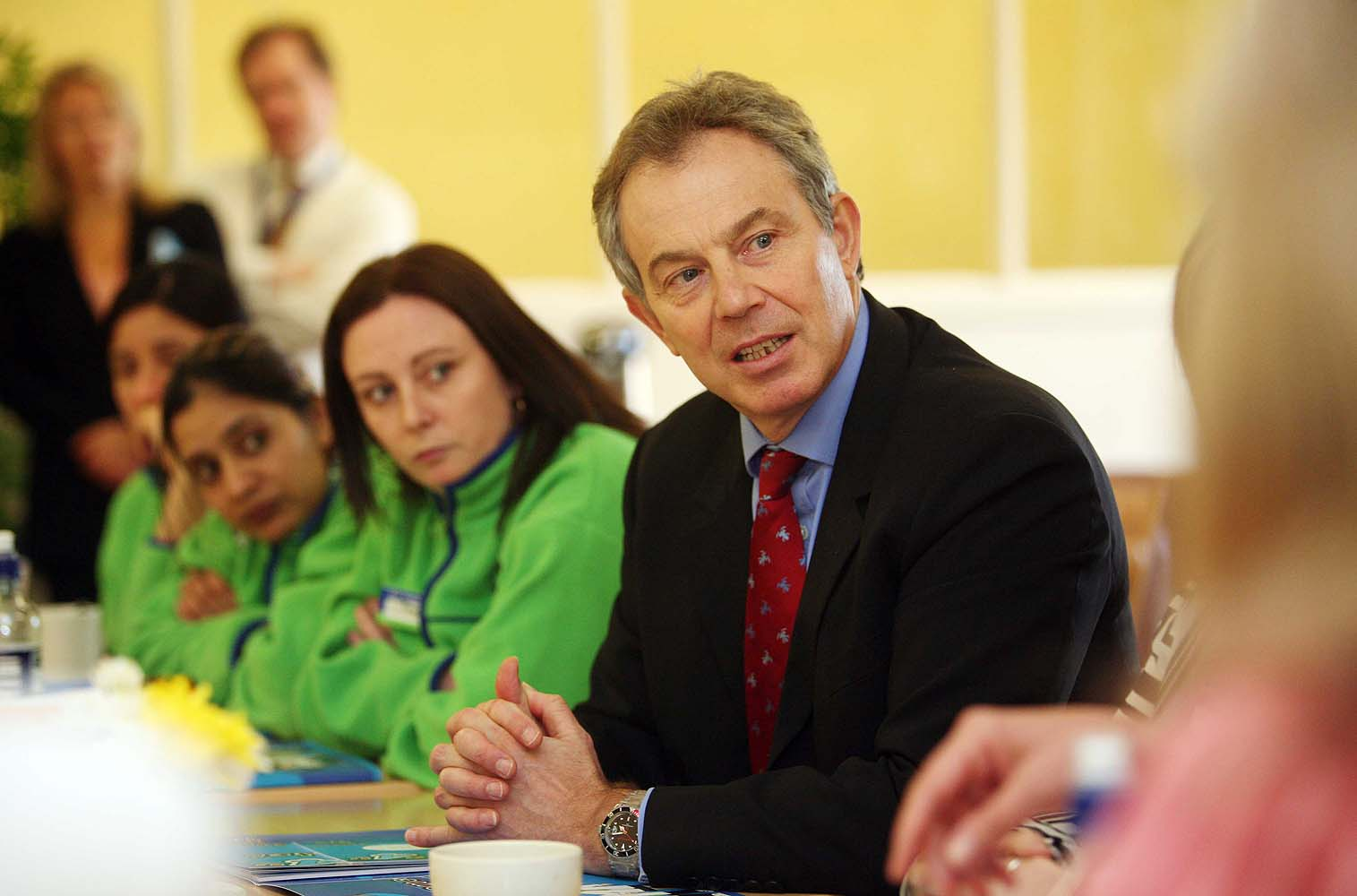 Tony Blair chats to staff during a visit to a ASDA store in South London. Client: ASDA.