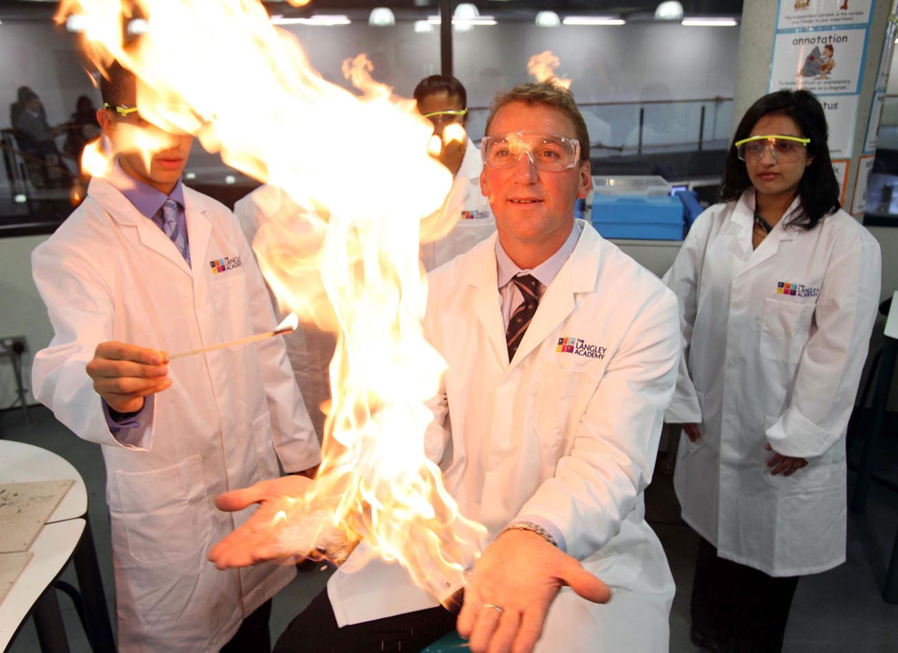 Sir Matthew Pinsent takes part in a science experiment at the official launch of The Langley Academy.